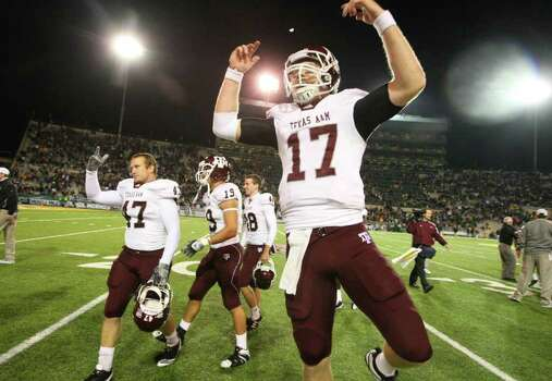 A&M quarterback Ryan Tannehill, celebrating the Baylor win last year, is one of 10 returning offensive starters — one reason the Aggies are ninth in the preseason coaches' poll. Photo: Jerry Larson/Associated Press