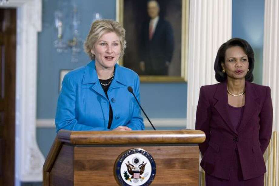 Undersecretary of State for Public Diplomacy and Public Affairs Karen Hughes, left, announces her resignation Wednesday, joined by Secretary of State Condoleezza Rice. Photo: J.Scott Applewhite, AP