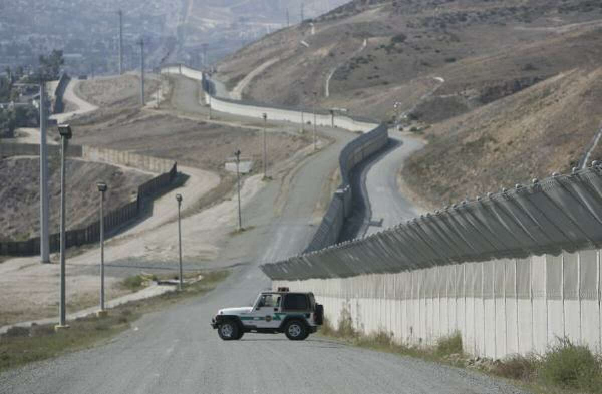 The bill requires that security be in place before other parts of the legislation are enacted. Provisions include 370 more miles of border fencing, such as this stretch near Chula Vista, Calif.