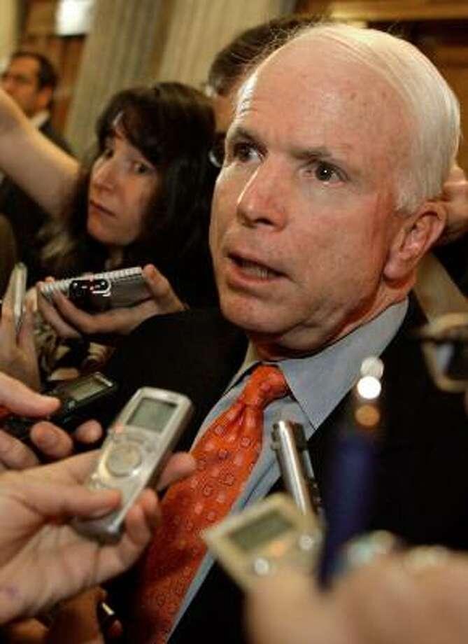 Sen. John McCain, R-Ariz., speaks to the media Tuesday outside the Senate chamber in Washington, D.C. Photo: C. SOMODEVILLA, GETTY IMAGES