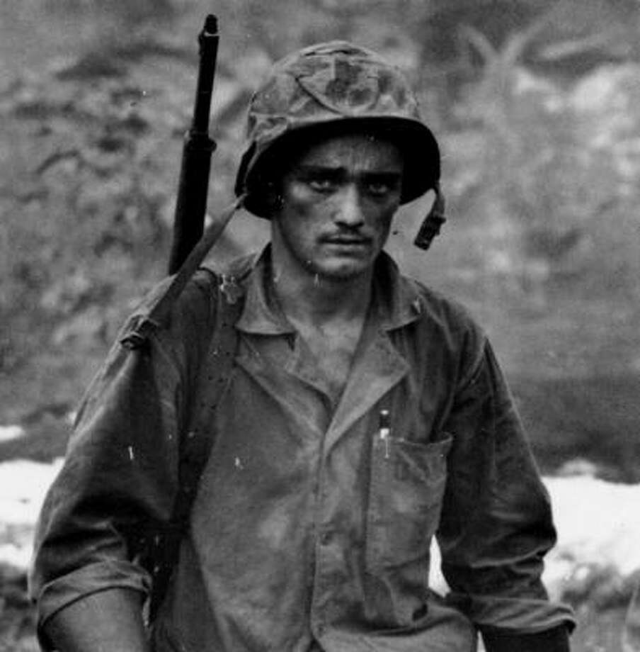 Ken Burns' documentary The War blends eyewitness accounts with images of World War II's front lines, including this one of a soldier in Saipan in 1944. Photo: U.S. National Archives