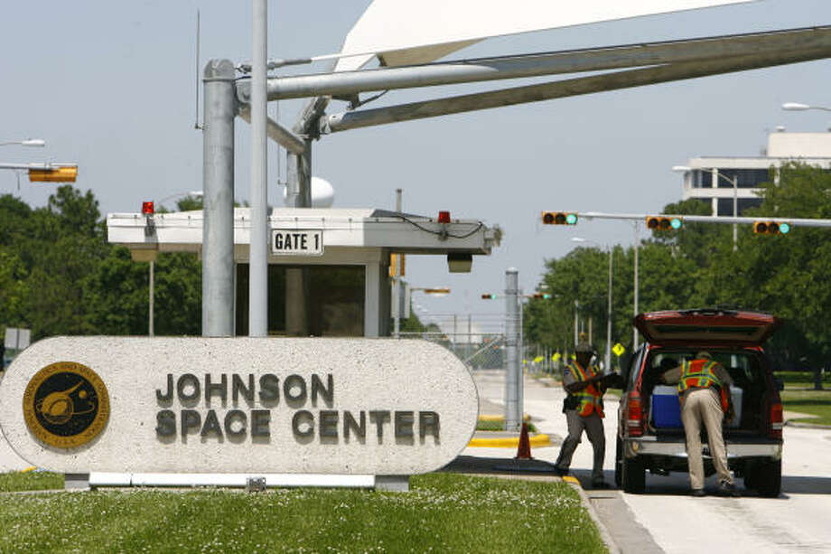 Security workers at the Johnson Space Center's Gate One look through a van and its contents Saturday. Photo: Nick De La Torre, Chronicle