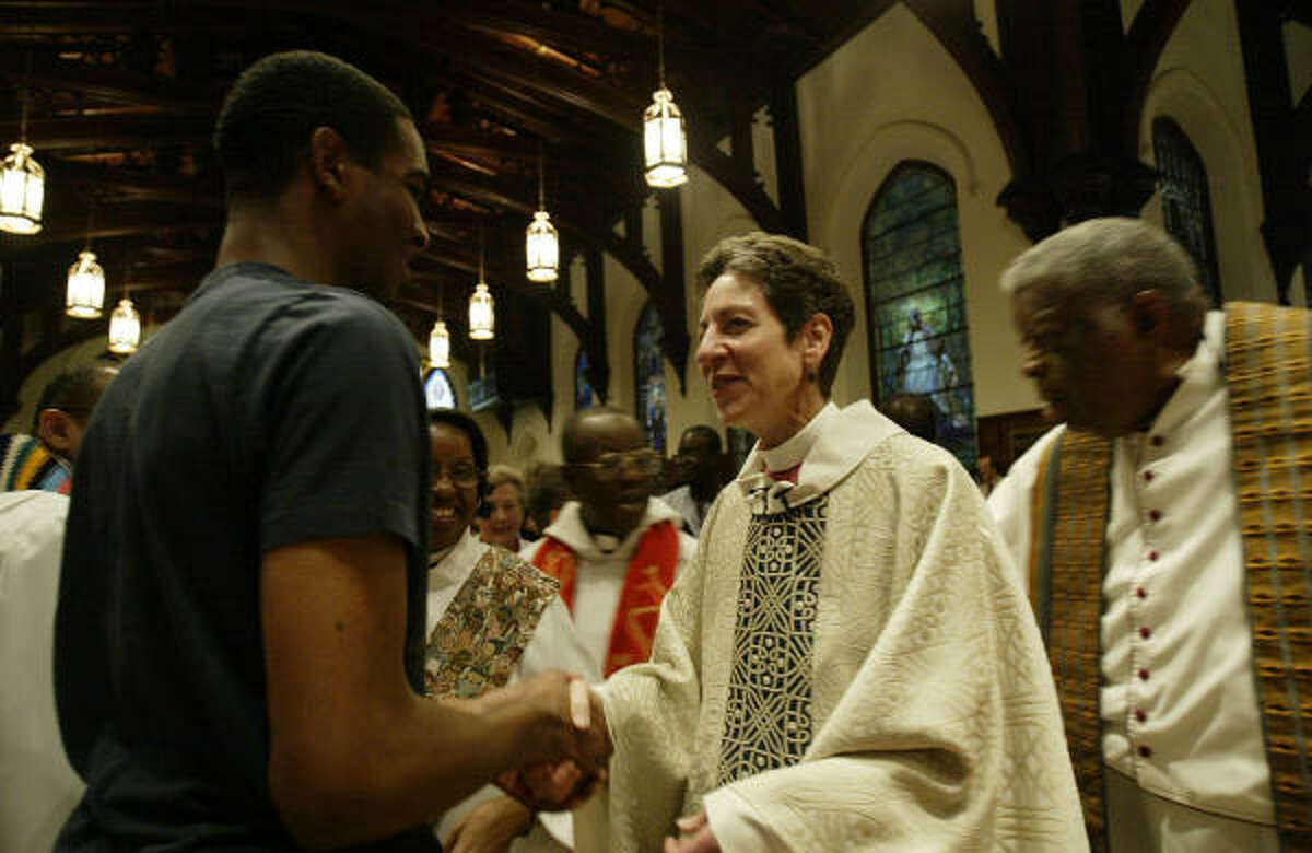 Episcopal Presiding Bishop Katharine Jefferts Schori greets participants in a ``reconciliation Eucharist'' at the annual Union of Black Episcopalians meeting at Christ Cathedral Church.
