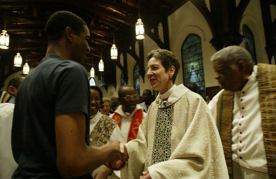 Episcopal Presiding Bishop Katharine Jefferts Schori greets participants in a ``reconciliation Eucharist'' at the annual Union of Black Episcopalians meeting at Christ Cathedral Church. Photo: Jessica Kourkounis, For The Chronicle