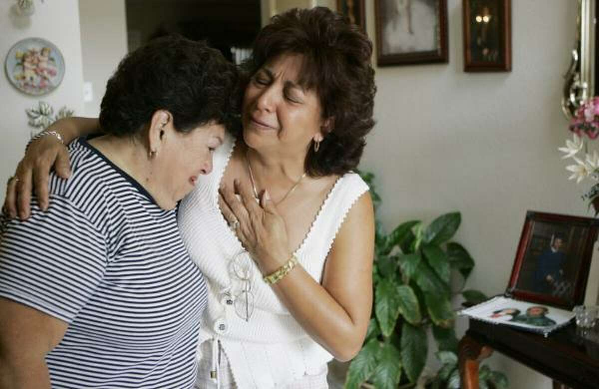 Olga Capetillo, right, mourns the death of her son, Sgt. Omar Mora, with her cousin, Bertha Oaks, in Texas City on Wednesday. Mora and six others were killed Monday in an accident in Iraq. He and another dead soldier had signed a public letter recently questioning the war.