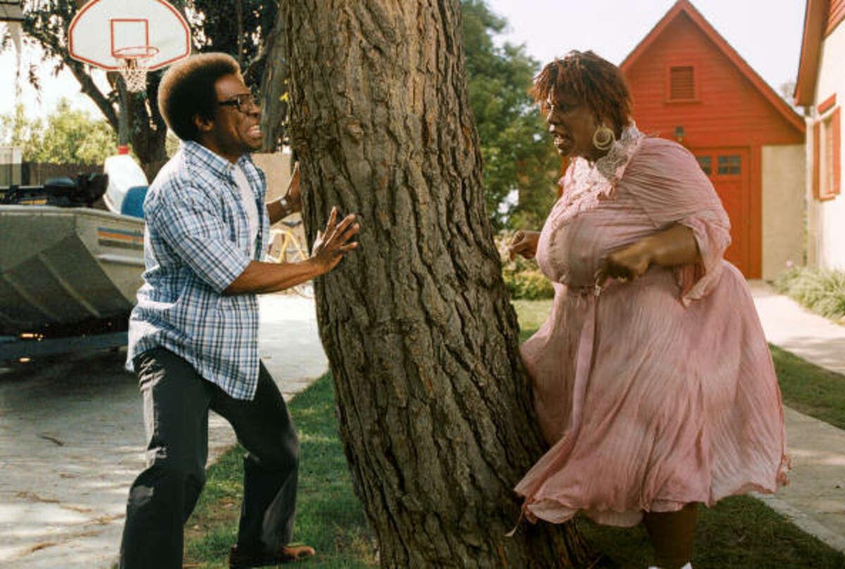Norbit (Eddie Murphy) finds himself up a tree in his relationship with Rasputia (Eddie Murphy), in Norbit.