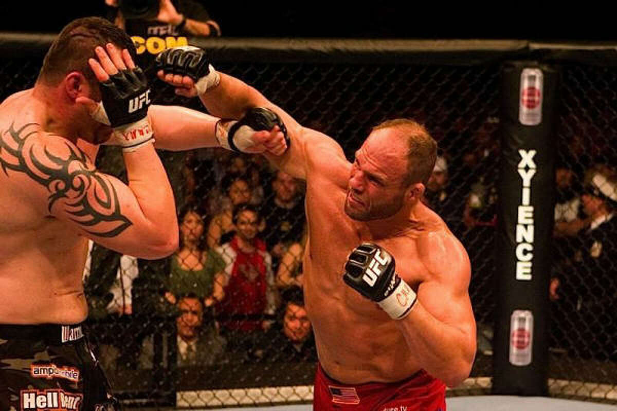 Randy Couture throws a punch at heavyweight champion Tim Sylvia at UFC 68. Couture beat Sylvia by unanimous decision to gain the heavyweight title.