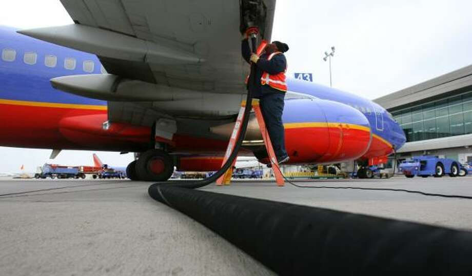 Thedus Hobbs refuels a Southwest Airlines jet at Hobby Airport earlier this year. Fuel costs have held back industry profits. Photo: SHARÓN STEINMANN, CHRONICLE