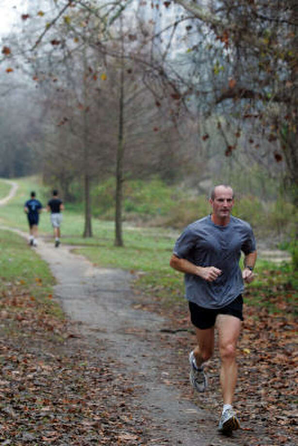 John Crockette, 43, of Houston gets in a training run for the Chevron Houston Marathon on the Sandy Reed Memorial Trail on a recent Saturday morning. Photo: Johnny Hanson, For The Chronicle