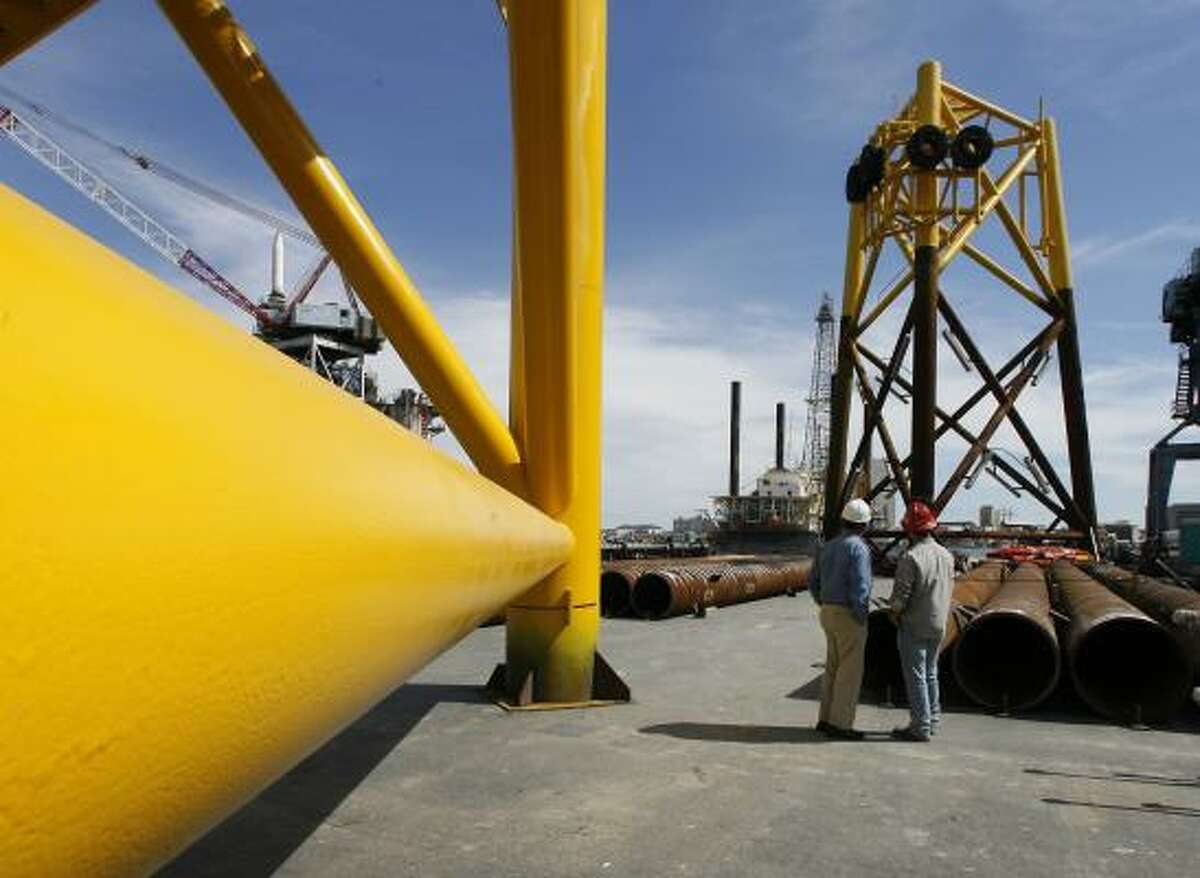 Dave Thomas, left, general manager of the Galveston Offshore Wind project, and Gulf Copper Yard Safety Supervisor John Beasley prepare for the installation of wind turbine platforms on Pelican Island on Tuesday.