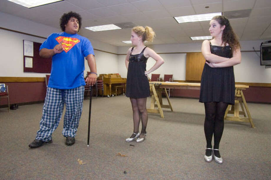"From left, George Thomas (GT) Mangum, as Jesus; Jessica Cragg, choreographer; and Renée Reinecke, student director, rehearse for the Memorial Drive UMC Youth Production of ""Godspell."" Photo: R. Clayton McKee, For The Chronicle"