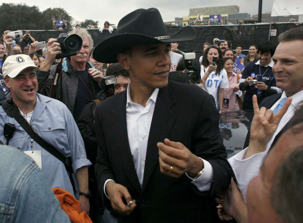 U.S. Sen. Barack Obama, D-Ill., wears a cowboy hat offered by a supporter after speaking at an outdoor rally Friday in Austin. Obama, who is seeking the Democratic presidential nomination in 2008, told more than 10,000 people that it's time to end the war in Iraq and turn the nation's attention to education and health care.