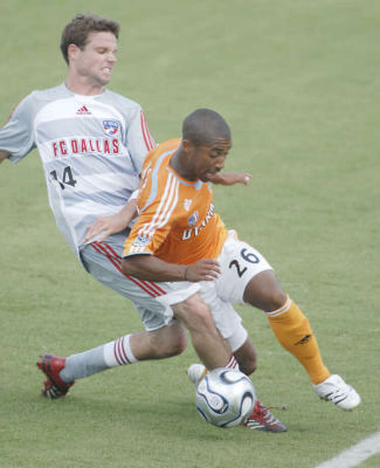 Contributions from rookie Corey Ashe (26) helped the Dynamo to a home win. He assisted on Joseph Ngwenya's goal in the 66th minute. Photo: TIM JOHNSON, CHRONICLE