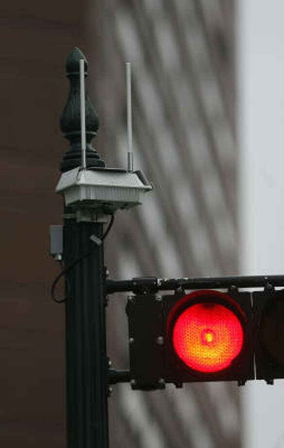 An access node for the Houston's wireless network is attached to a traffic light at the corner of Milam and Prairie. Photo: Steve Campbell, Chronicle
