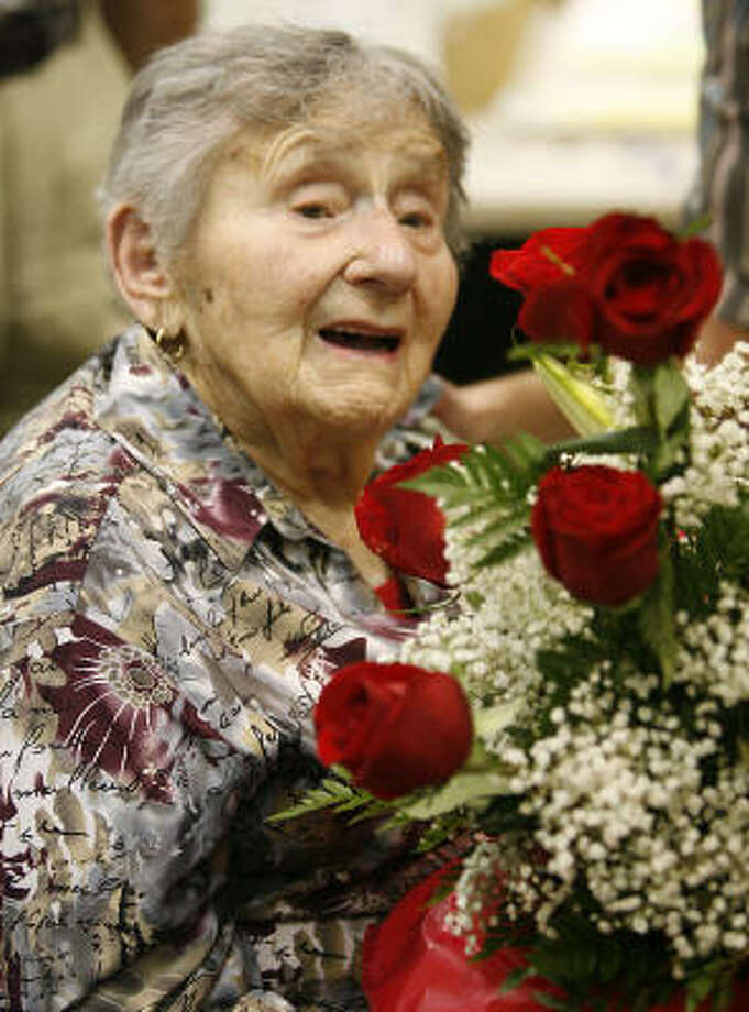 Holocaust survivor Riva Kremer  who turned 100 on Aug. 12, 2006, receives a bouquet of roses during a birthday celebration in her honor, at the Houston Holocaust Museum on Aug. 13 last year. She survived 10 camps and was liberated from the concentration camp Terezienstadt in Czechoslovakia on May 8, 1945. She moved to Houston in 1965. Photo: Billy Smith II, HOUSTON CHRONICLE
