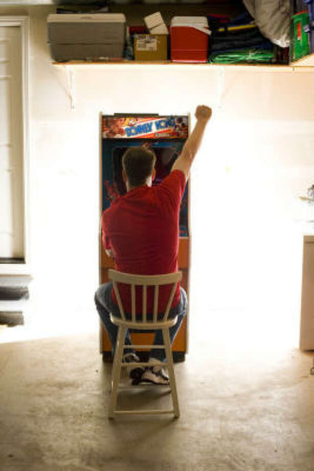 Steve Weibe during game-play in his garage in the movie King of Kong. Photo: Picturehouse
