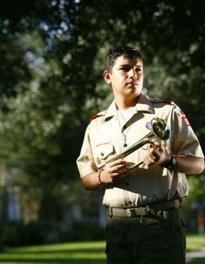 Erik Gonzalez, 14, says he became interested in being a bugler through Boy Scouts. Photo: NICK De La TORRE, CHRONICLE