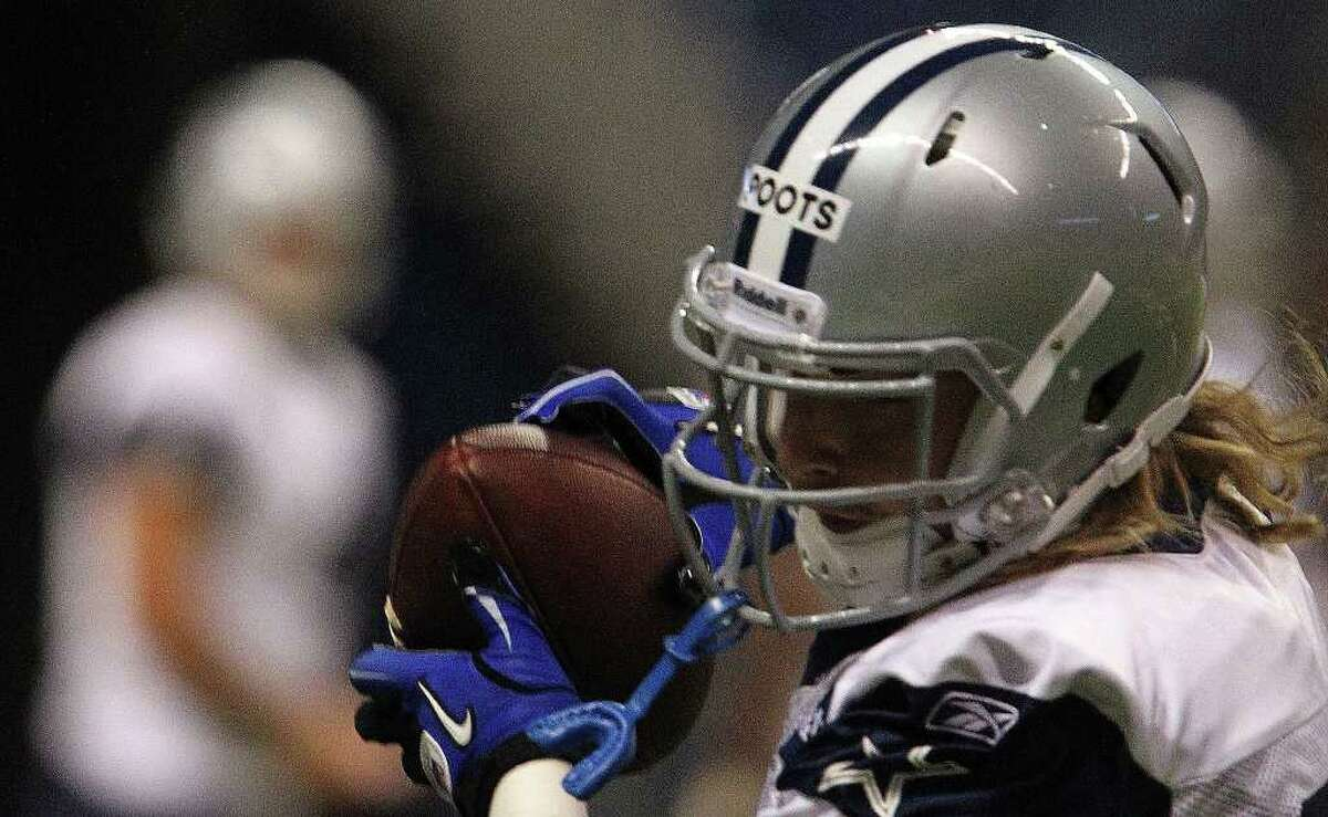 Cowboys wide receiver Tysson Poots receives a pass on Tuesday, Aug. 9, 2011 during training camp at the Alamodome.