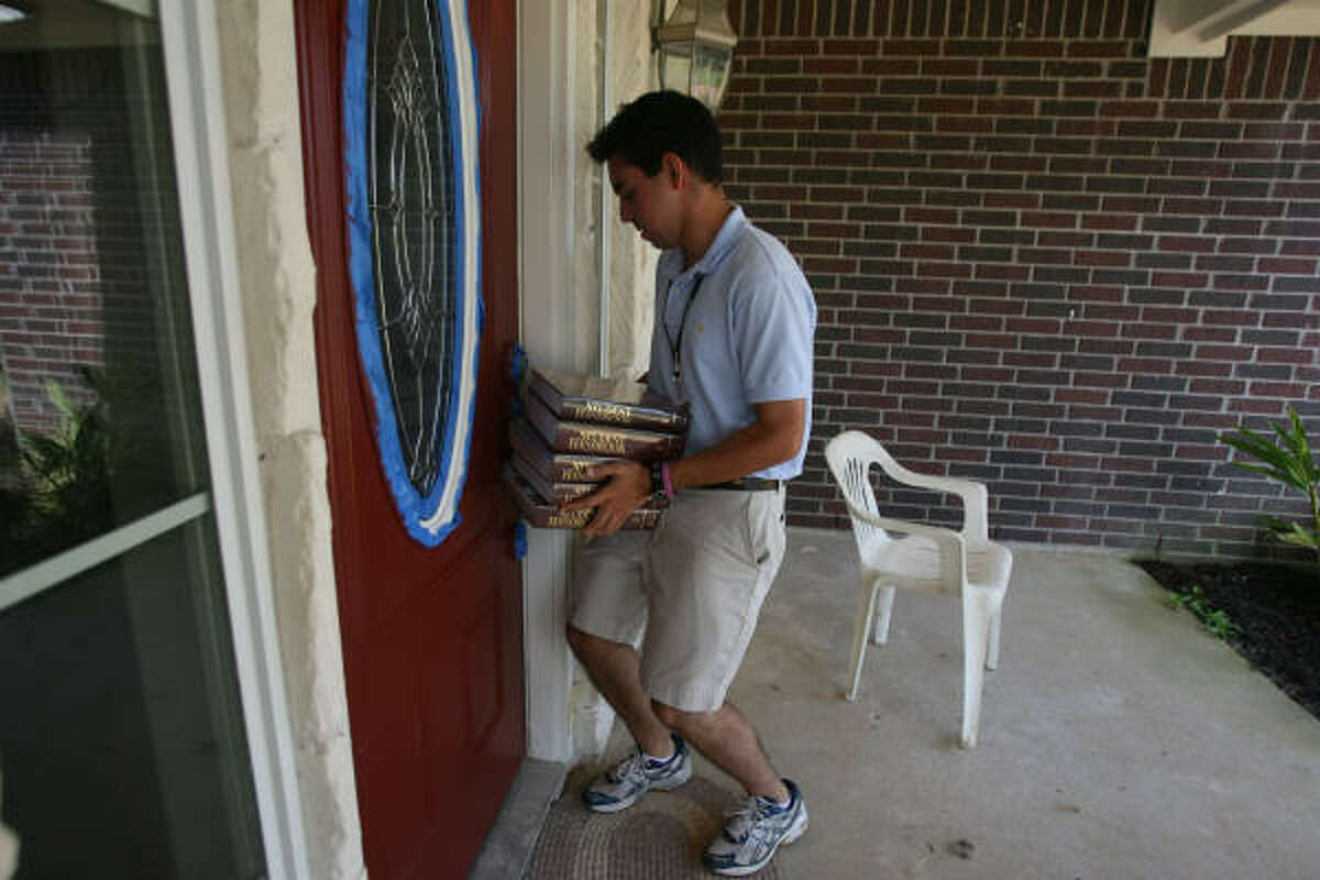 Southwestern Company's Shayan Shakiba pushes his way back into a home after making a book sale to a Liberty County resident.