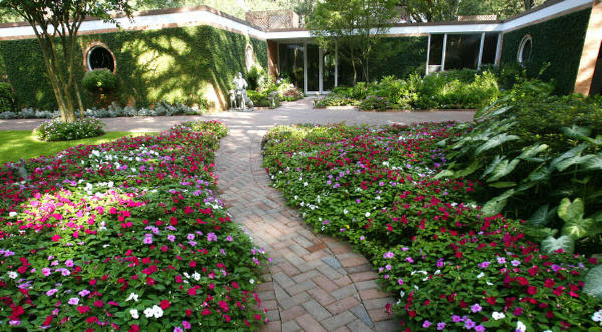 """The Mosbachers house was designed by the late architect Hugo V. Neuhaus Jr. and was a postmodern creation meant to blend into the landscape. Suzanne Longley has rejuvenated C.C. """"Pat"""" Fleming's original garden design."""
