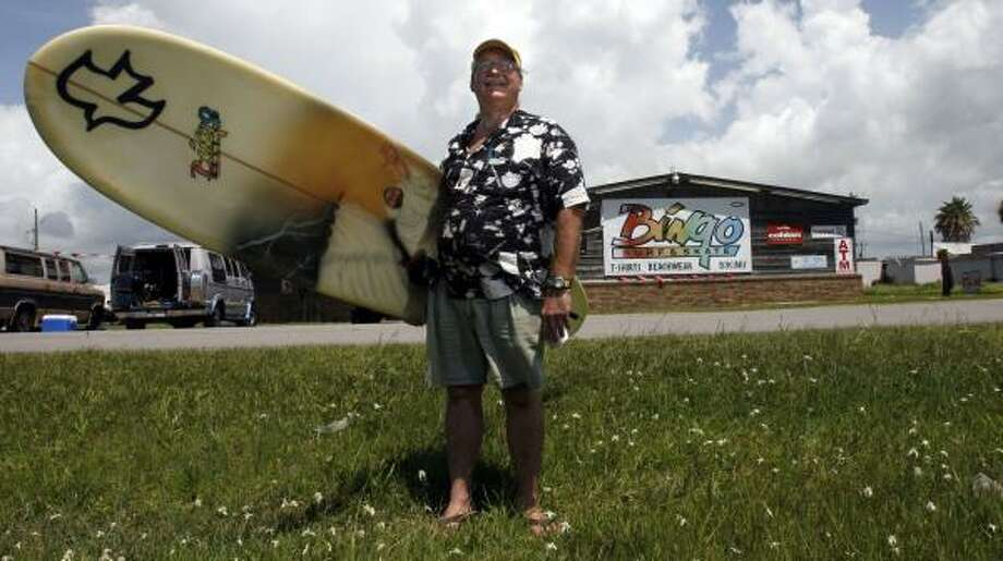 "Bingo Cosby, owner of Bingo Boards surfboard shop in Surfside Beach, didn't flee from Hurricane Rita and says he has no plans to evacuate from any future storm that may threaten the area. ""I just pray, "" he said. ""I prayed when they said Rita was going to hit us, and it didn't."" Photo: JOHNNY HANSON, FOR THE CHRONICLE"