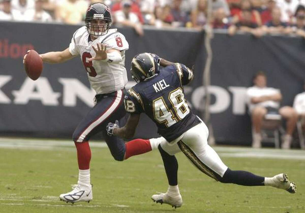 Terrence Kiel, shown chasing Texans QB David Carr during a 2004 game, hopes to latch on to another team after the Chargers declined his option for 2007.
