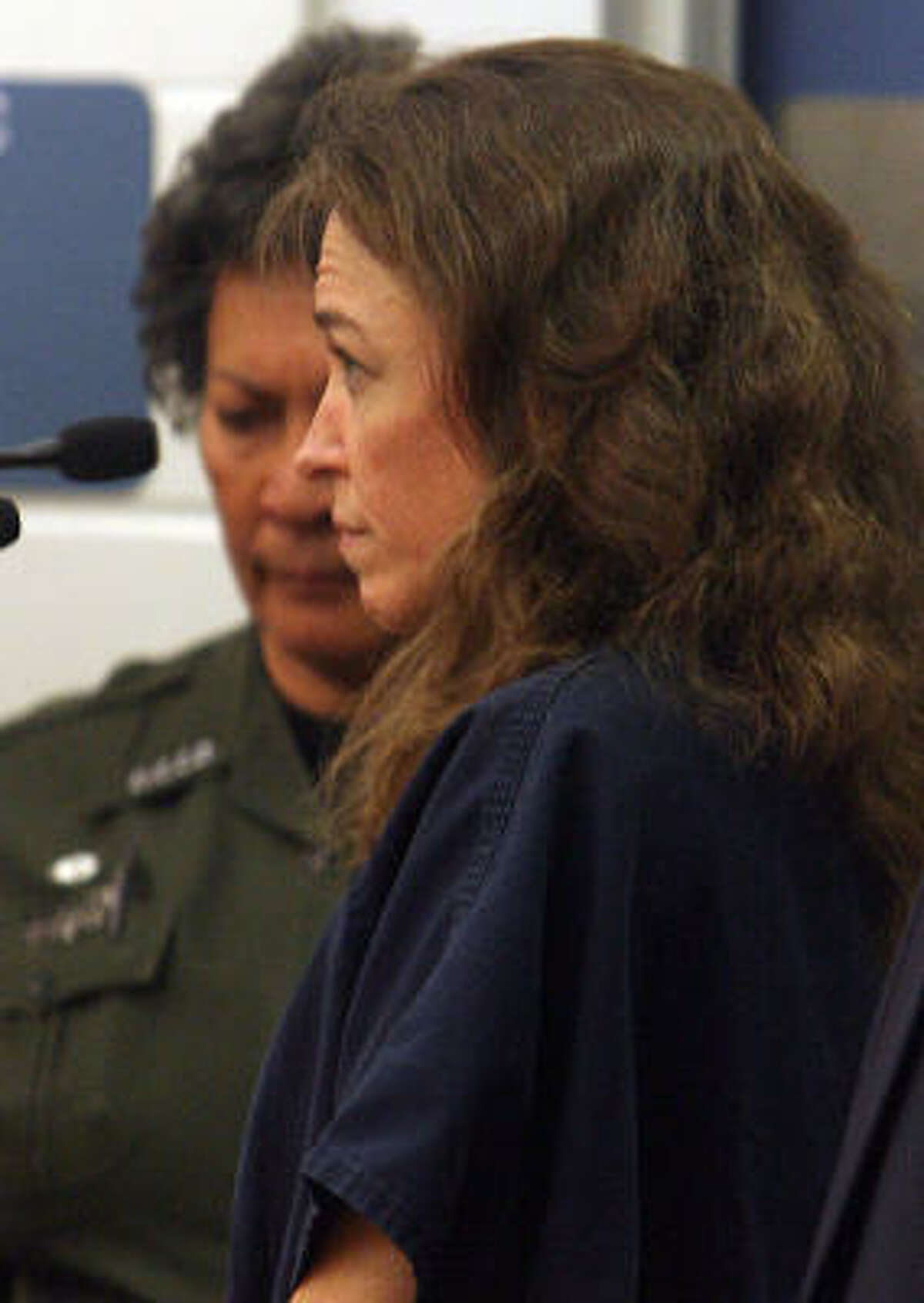 Lisa Nowak, foreground, makes her initial court appearance Feb. 6 in Orlando, Fla.