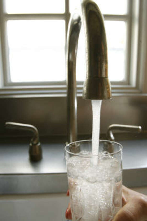 Drinking tap water instead of bottled water is on the upswing. Photo: Kevin Fujii, Chronicle