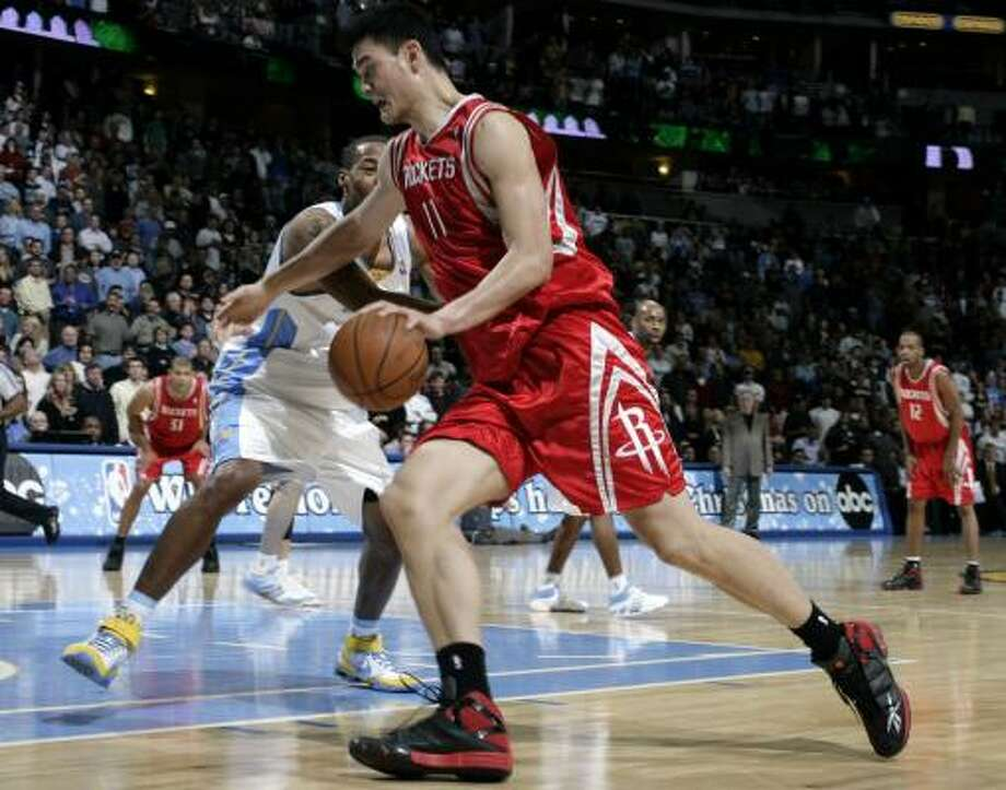 If the Rockets trade a star, it won't be Yao Ming (shown on Thursday against host Denver), columnist Jerome Solomon writes. Photo: David Zalubowski, AP
