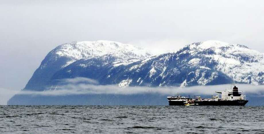 An oil tanker maneuvers through Prince William Sound near Valdez, Alaska. The Union of Concerned Scientists charged that Exxon Mobil supported groups that are attempting to discredit the science behind global warming. Photo: David McNew, Getty Images File