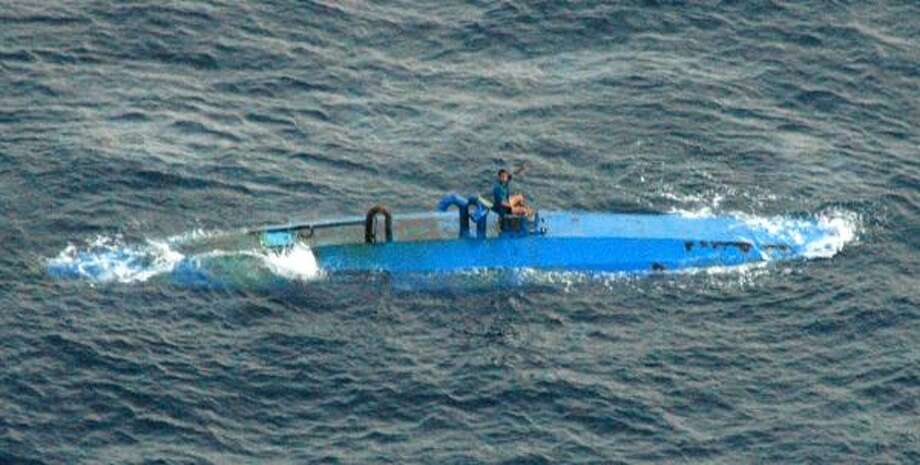 The U.S. Coast Guard intercepted a self-propelled, semi-submersible vessel in the Pacific off the coast of El Salvador. The four people aboard sank the vessel shortly before they were arrested. Authorities found 11 bales of cocaine floating nearby. Photo: U.S. NAVY, ASSOCIATED PRESS