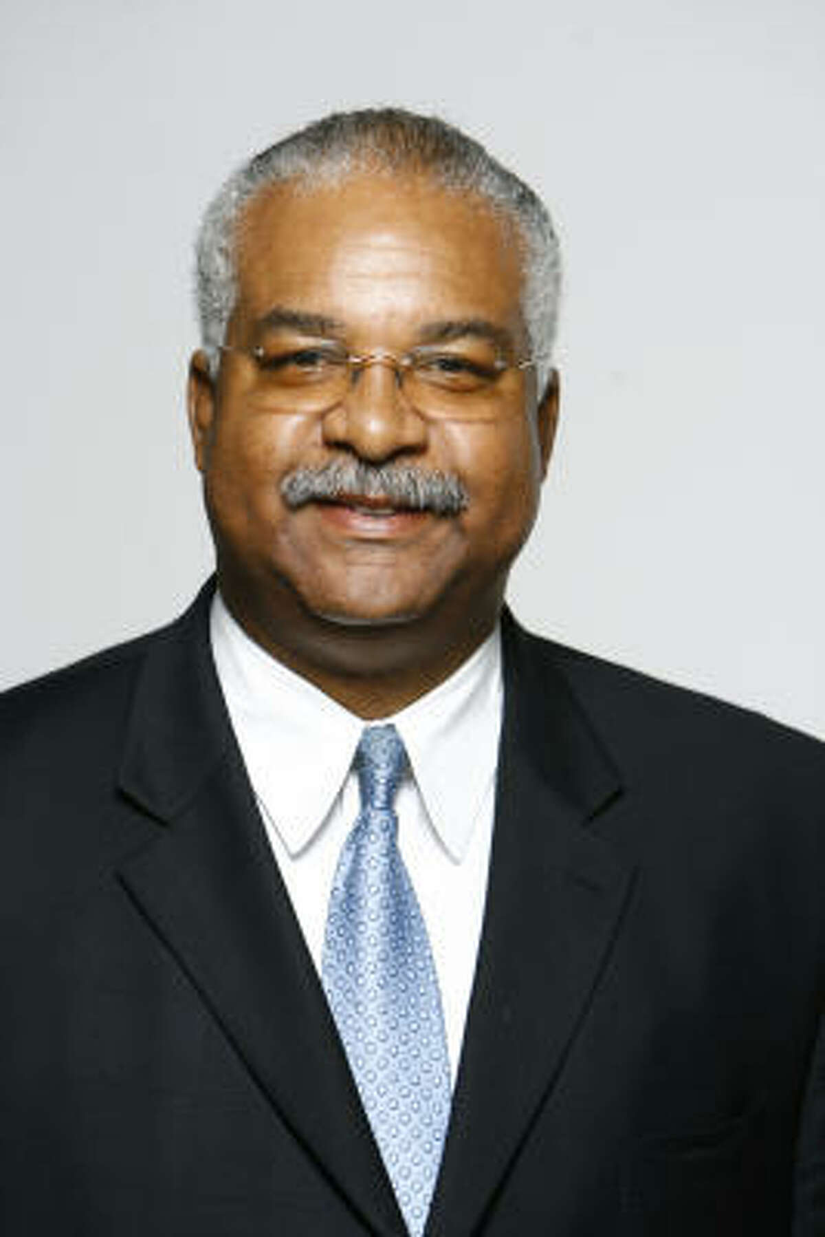 At-Large Position 5 candidate John C. Gibbs was indicted for felony assault after hitting his wife with a belt in 1998.