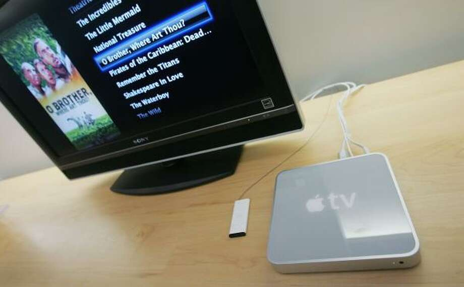 Apple TV isn't a television set but a device that lets you move anything downloaded from iTunes on your Mac or PC to your TV. It retails for $299. Photo: MARIO TAMA, GETTY IMAGES