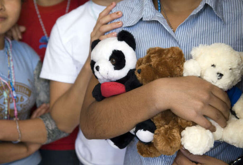 The 62 ``unaccompanied'' teens at Bokenkamp Children's Shelter earn points through school and other activities, a ``currency'' that buys donated toy bears, candy and toiletries. The youths at the emergency shelter are from Central and South America. Photo: Eddie Seal, For The Chronicle