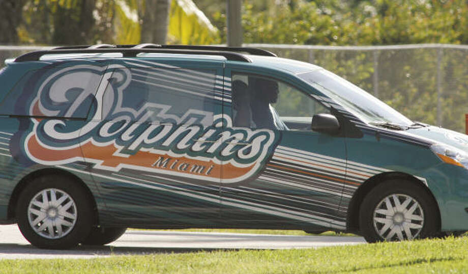 Ricky Williams arrives Thursday at the Dolphins' practice facility in Davie, Fla. Photo: JON WAY, AP