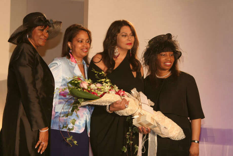 Receiving applause at the Ivy Educational and Charitable Foundation of Houston scholarship luncheon were honoree committee co-chair Sheri Cole, from left, foundation president and luncheon chair Marsha Penn, honoree Tina Knowles and luncheon co-chair Karen Aubrey. Photo: Gary Fountain, For The Chronicle