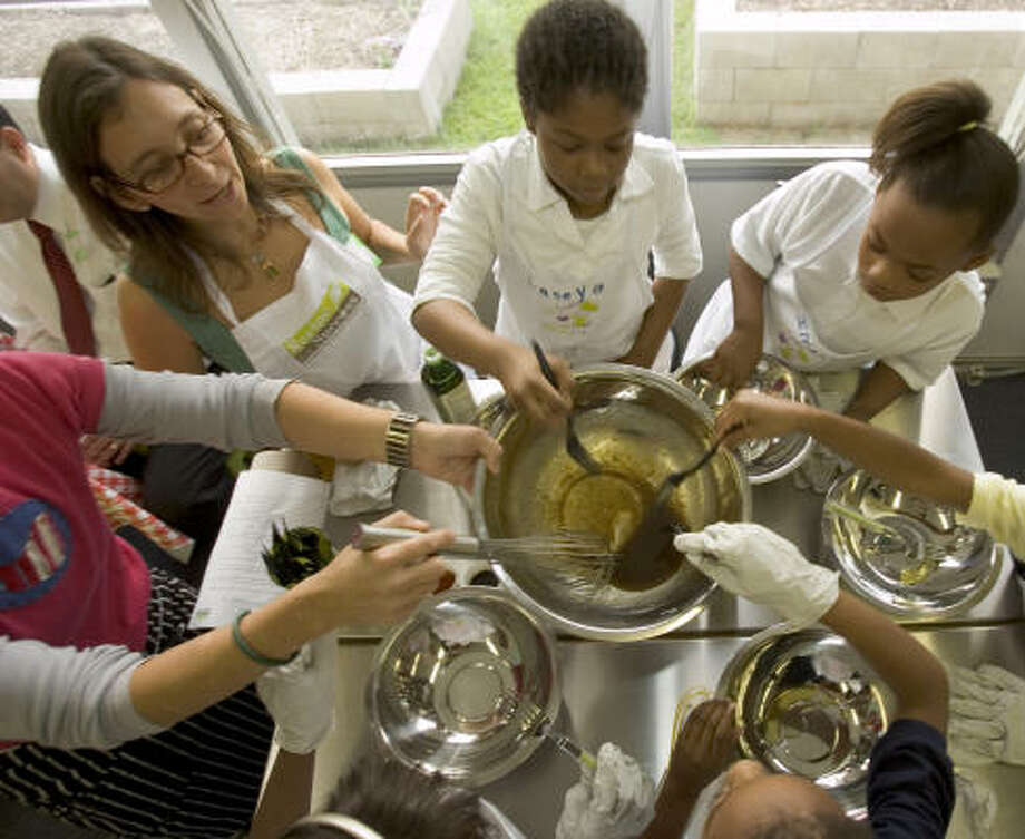 MIX IT UP:Fourth graders in a Recipe for Success class at MacGregor Elementary School mix salad dressing. Photo: Brett Coomer, Chronicle