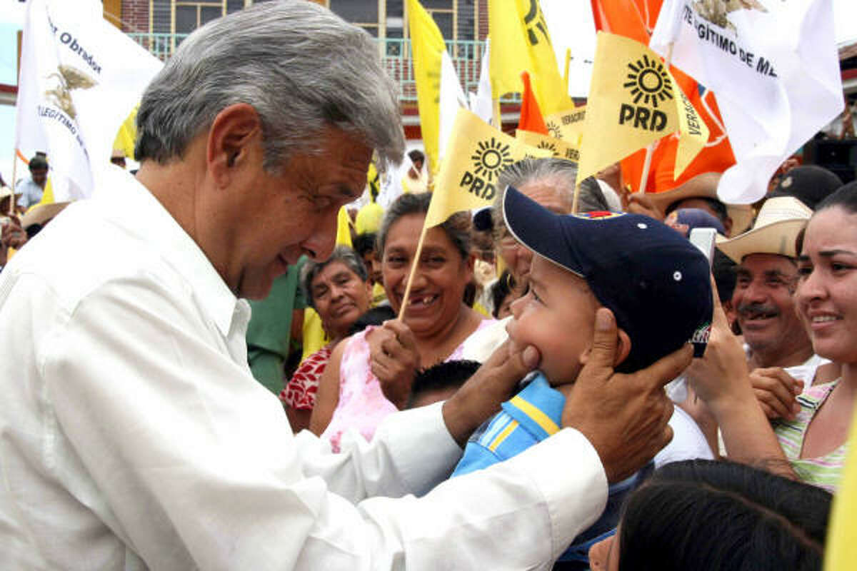 """Andres Manuel Lopez Obrador greets supporters during a June 21 rally in the Mexican town of Paso del Macho, Veracruz. The former presidential candidate, who claims he was defrauded of victory, has been criss-crossing the country since being """"sworn-in"""" by supporters as the """"legimitate president of Mexico"""" in November."""