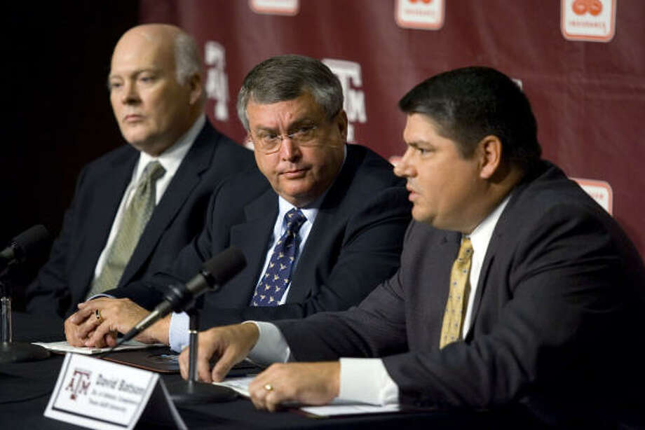 Scott Kelly, left, general counsel at Texas A&M University, and Bill Bryne, center, the school's athletic director, listen as David Batson, director of athletic compliance, discusses actions to be taken after an investigation into coach Dennis Franchione's VIP Connection newsletter during a press conference Thursday. Photo: Paul Zoeller, AP