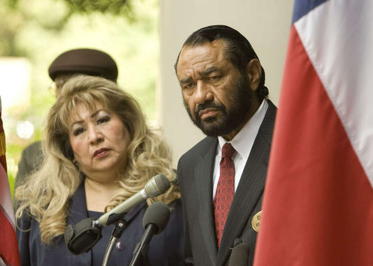 Mary Ramos, of the League of United Latin American Citizens, and U.S. Rep. Al Green, D-Houston, speak out Thursday on the steps of Houston's federal building.