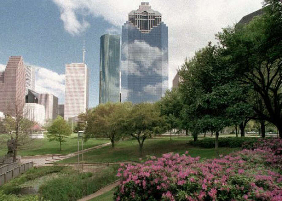 Azaleas and oaks in Sam Houston Park frame Houston's skyline. Photo: E. Joseph Deering, Chronicle