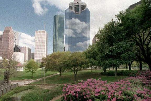 Azaleas and oaks in Sam Houston Park frame Houston's skyline.