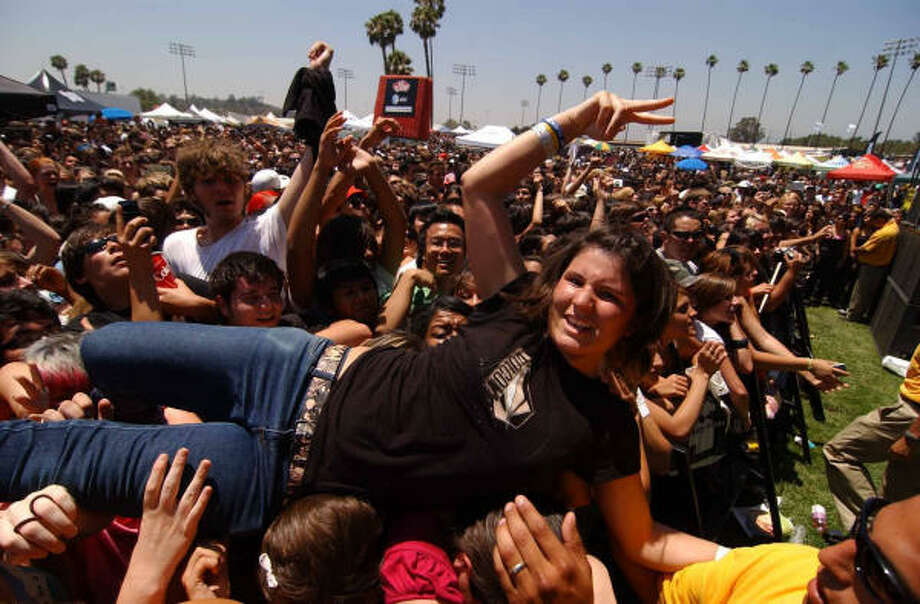 Maria Martinez, 17, crowd surfs during Boys Like Girls' set at the Warped Tour stop in Pomona, Calif. last month. Photo: Walter Richard Weis, Associated Press