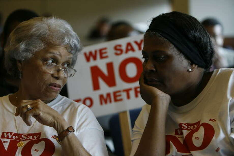 Mable Guidry, left,  and Jewell Bass, right, among a group opposed to light rail on Wheeler. Photo: Melissa Phillip, Chronicle