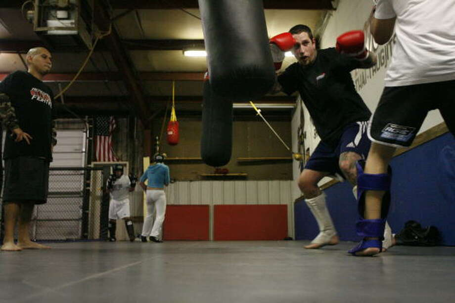Fighters work out at the Revolution Dojo gym where Sammy Vasquez trained for a recent Renegade series bout. Photo: Kevin Fujii, Chronicle