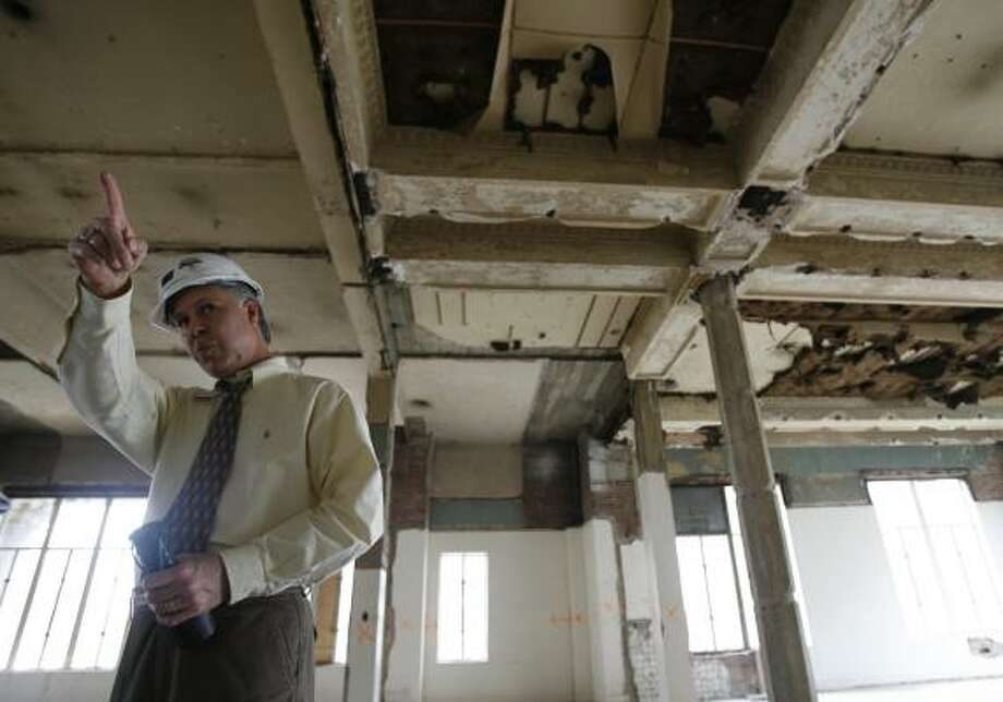 Dan Reissig, of the county's architectural and engineering division, surveys a gutted area awaiting renovation. Photo: KAREN WARREN, CHRONICLE
