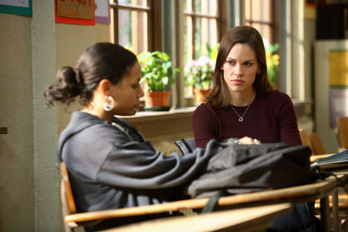 """California teacher Erin Gruwell (Hilary Swank) transforms a class of """"unteachable"""" kids (including April Lee Hernandez, left) into a group of social crusaders in Freedom Writers."""