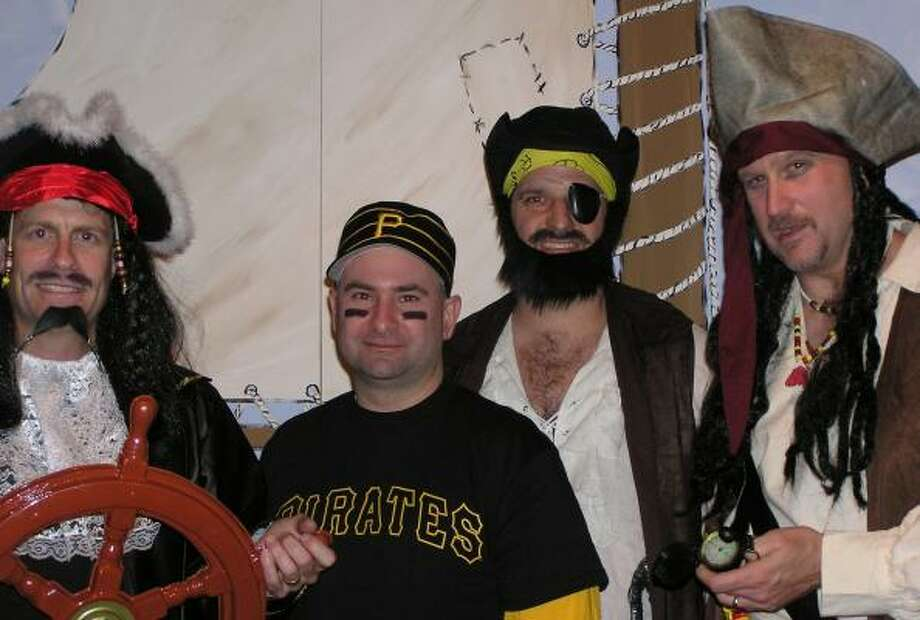 Using a pirates' theme for the Partners Campaign are Jeff McBride, left, of the YMCAs of Fort Bend County; Mike Batiato of the Katy Family YMCA; Brian Haines of the T.W. Davis Family YMCA; and Charlie Myer of the Fort Bend Family YMCA.