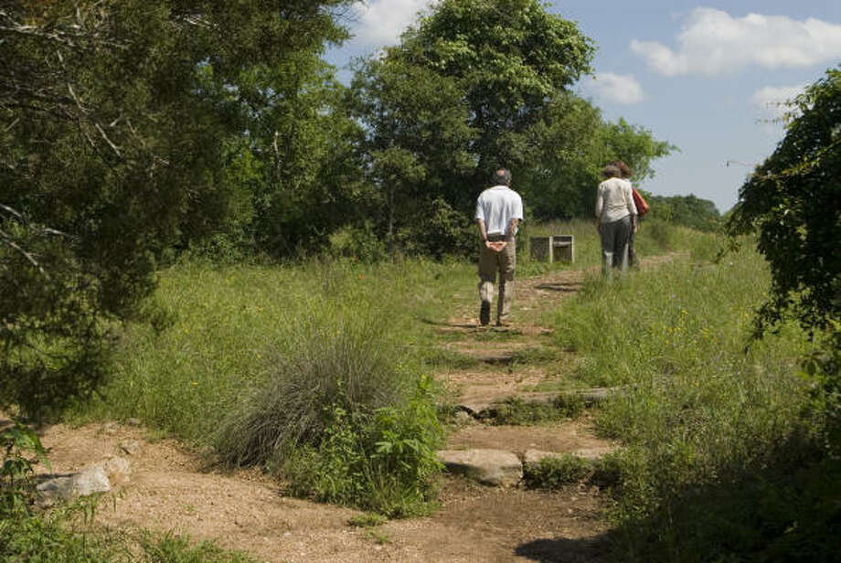 These hikers start off on the Savanna Meadow Trail. Photo: Mark Matson, For The Chronicle