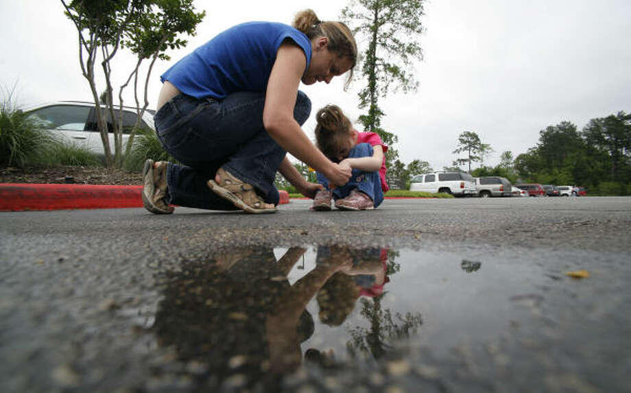 Zoë Dunn sets the pace when she and Mackenzie Levert are out in the world, so a walk across a parking lot may require sitting down to absorb what's going on around them. Photo: Steve Ueckert, Houston Chronicle
